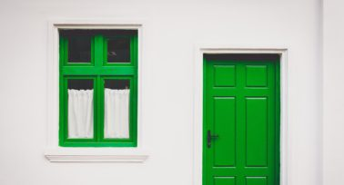 A green door of a property | Vivo Property Buyers