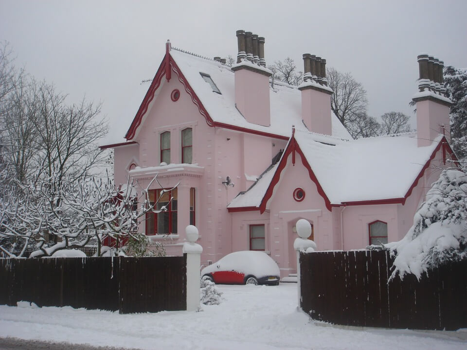 A house in wintery snow, a difficult time to sell your house