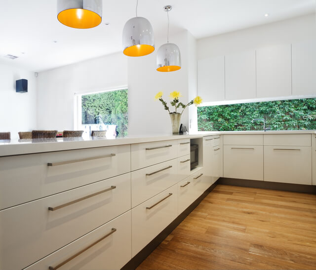 Metal feature lighting over a kitchen island is a quick way to modernise your ktichen