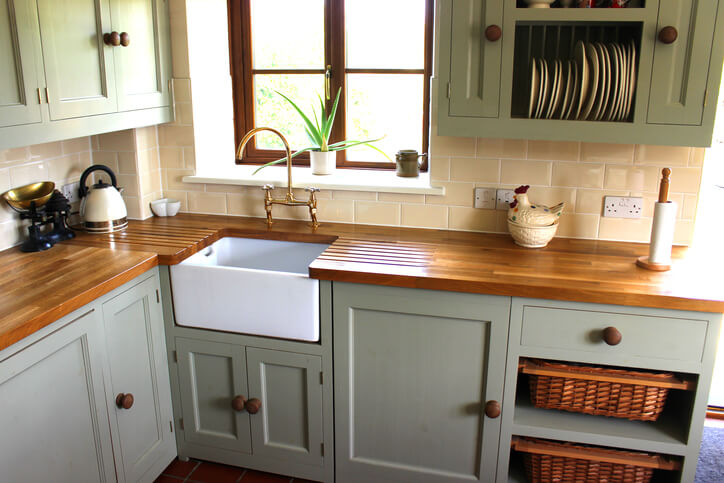 painted kitchen cupboards are a cheap way to improve your kitchen
