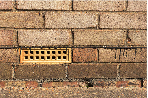 A ventilation brick helping to protect a house from flooding from exterior walls