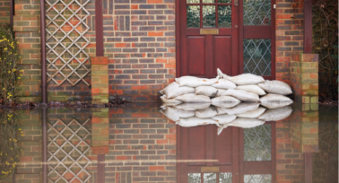 Sanbags protecting a house from flooding