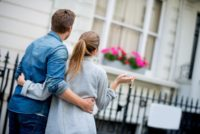 Two people outside a house after property chain problems