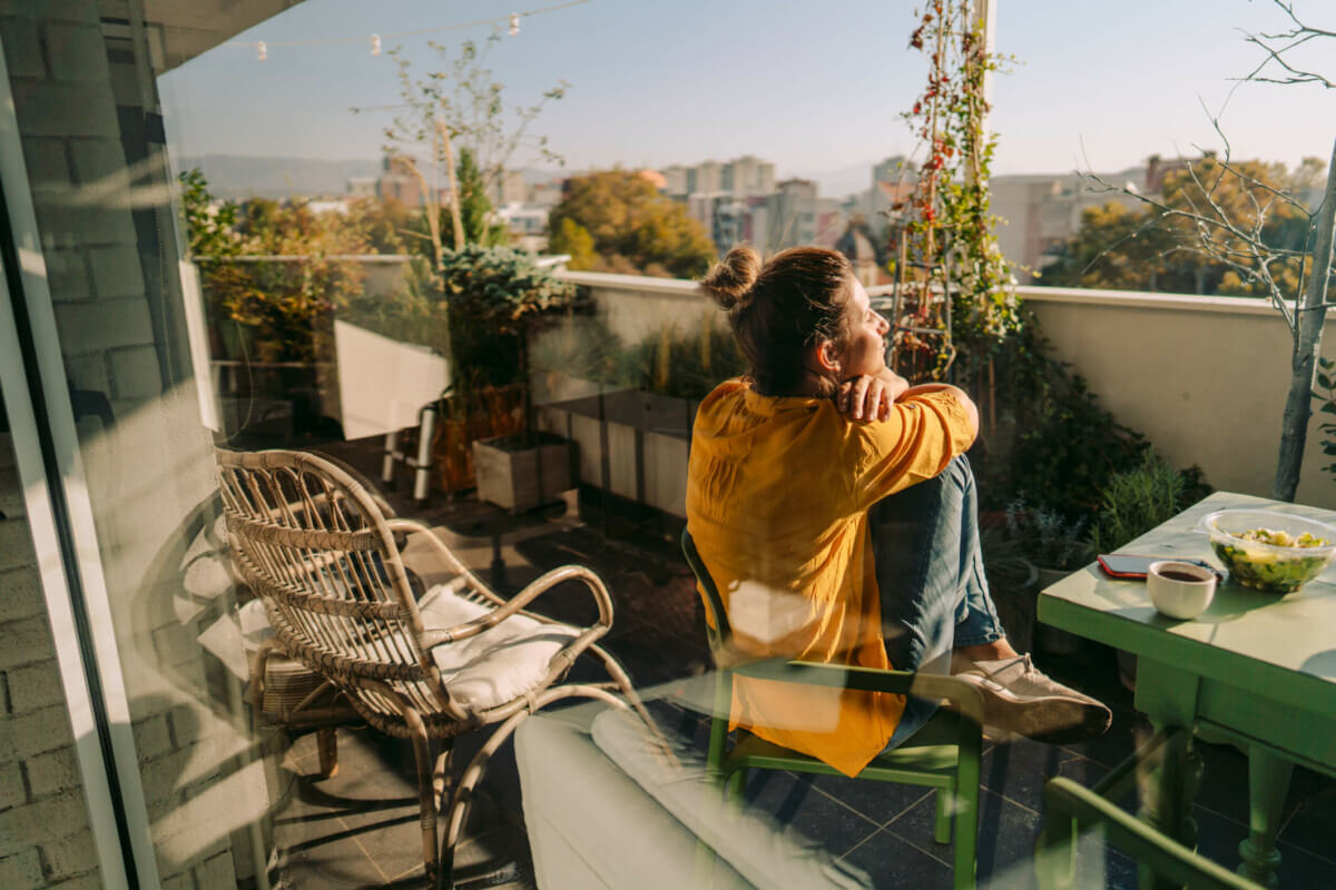 Woman relaxing in a property she just bought from iBuyers